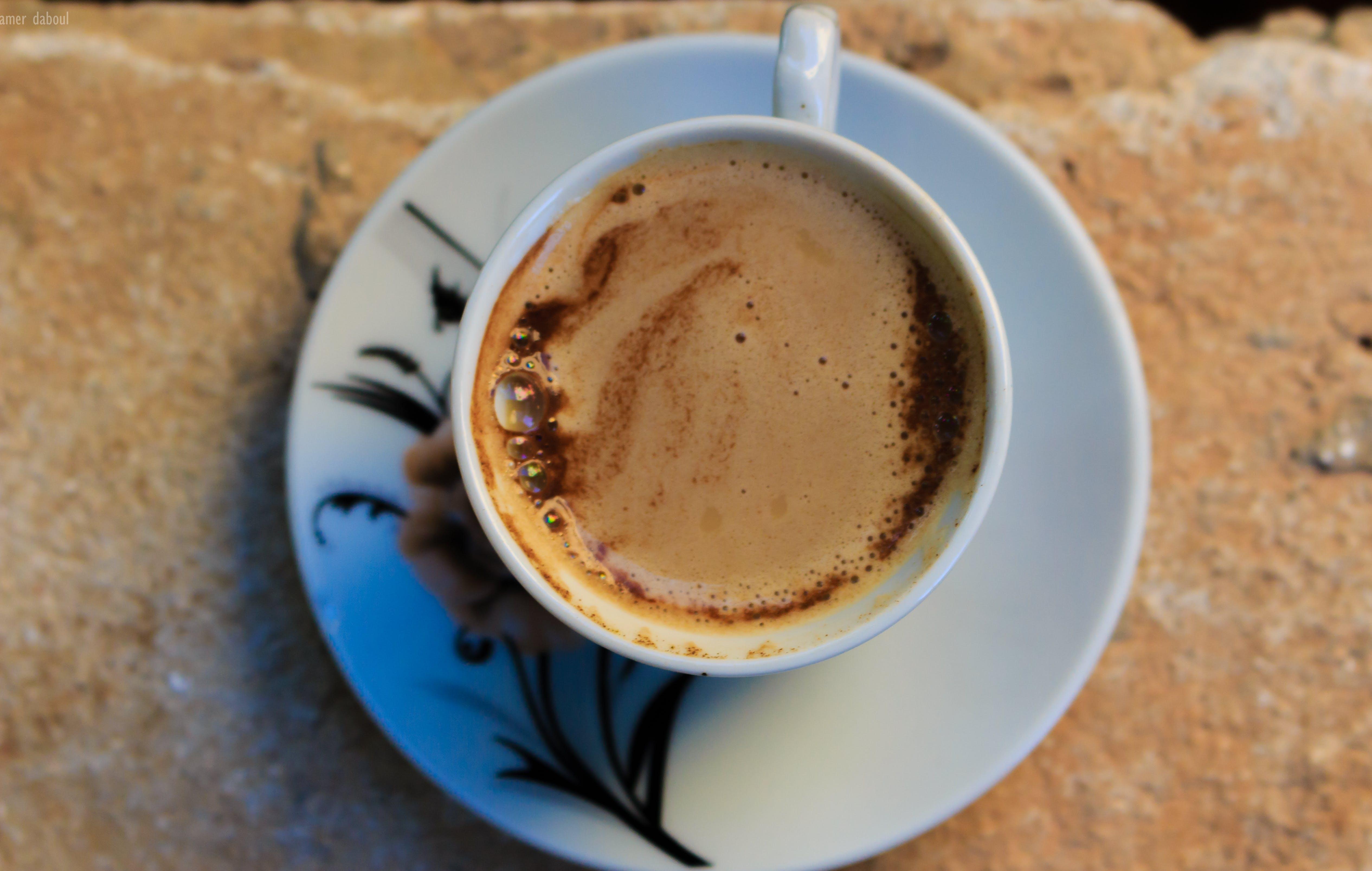 White Ceramic Mug With Coffee and White Ceramic Saucer