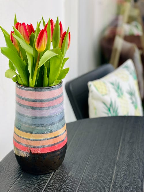 Green and Red Flower on Brown Wooden Table