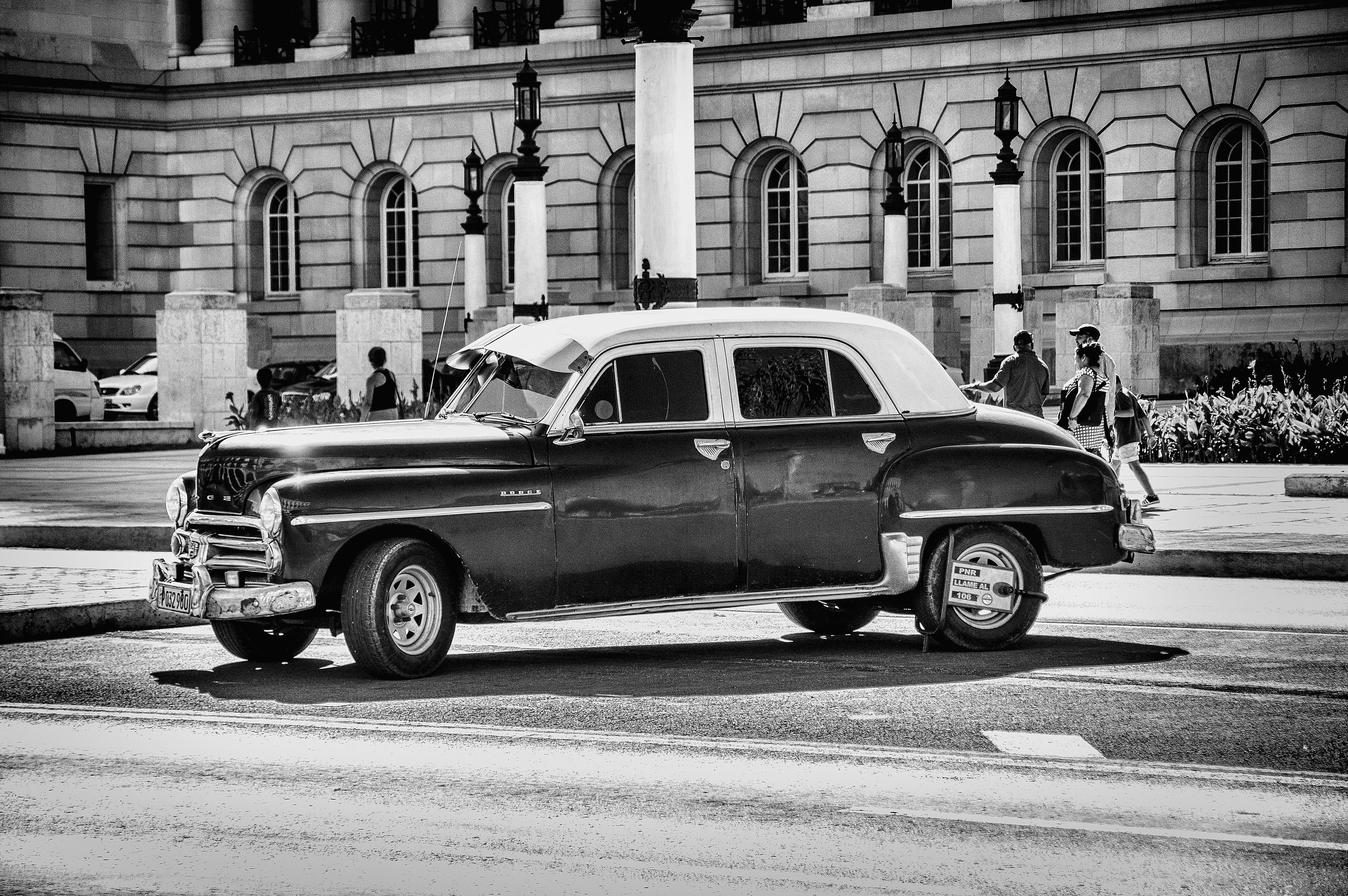 Grayscale Photo of Classic Chevrolet Sedan