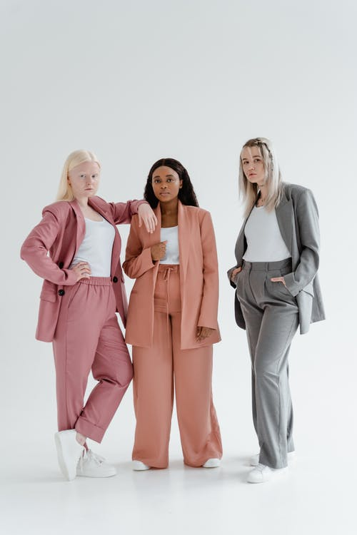 Women in Blazers and Pants Standing Side by Side
