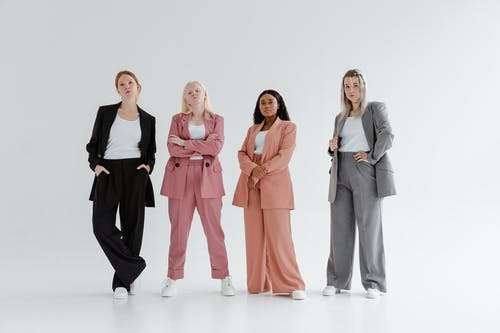 Women in Business Coats on White Background