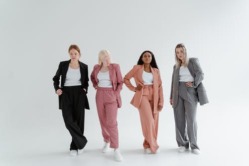 Women Posing on a White Background