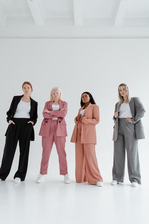 Women Standing on a White Studio
