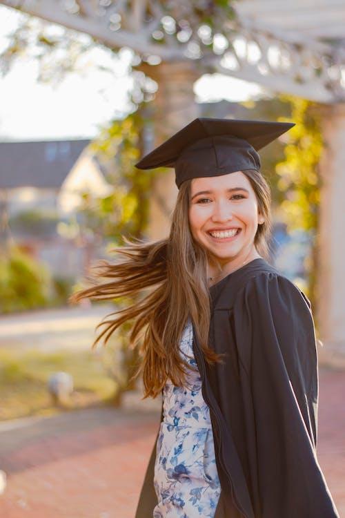 Woman in Black Academic Dress Smiling