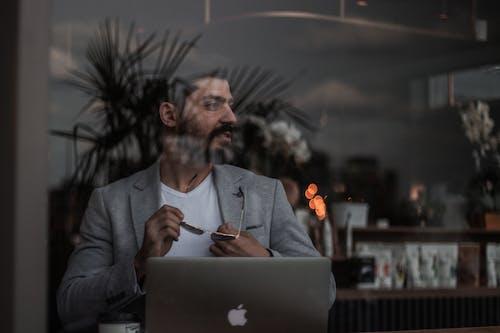 Man in Gray Suit Jacket Using Macbook
