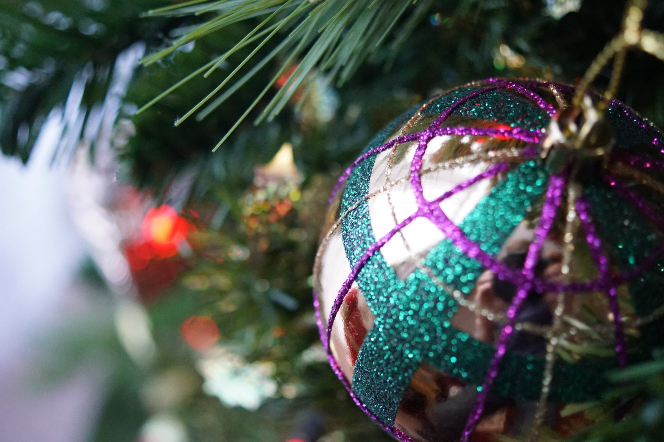 Grey and multicolored ornament on a tree