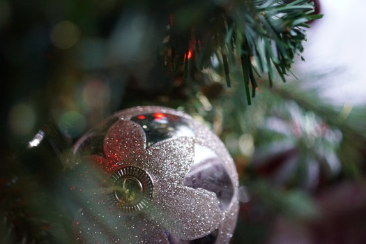 Silver Christmas Bauble Hanging on Christmas Tree