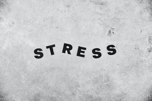 Backdrop of Stress inscription on rough wall