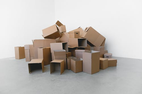 Stack of carton boxes on floor in rented house