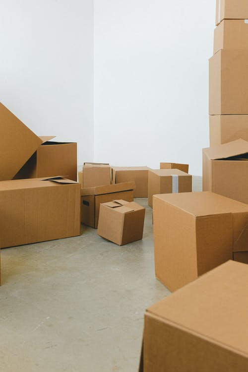 Piles of carton containers on floor in new house