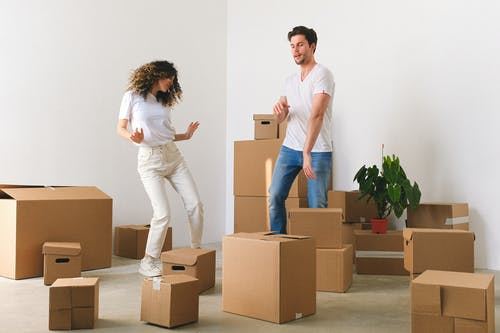 Man and Woman Dancing Around the Boxes