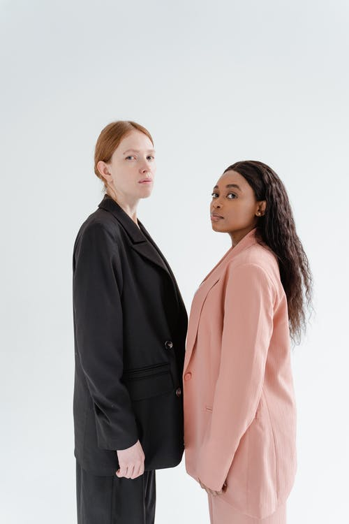 Women Standing Together with White Background
