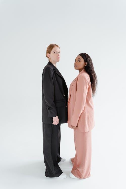 Women in Blazer Standing Together