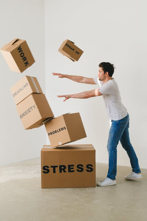 A man pushing away cartons