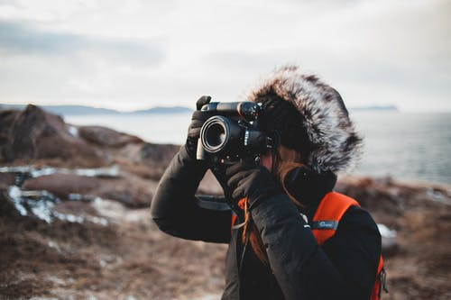 Photographer taking photo of landscape