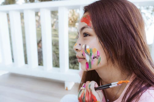 Girl With Blue and Pink Floral Face Paint