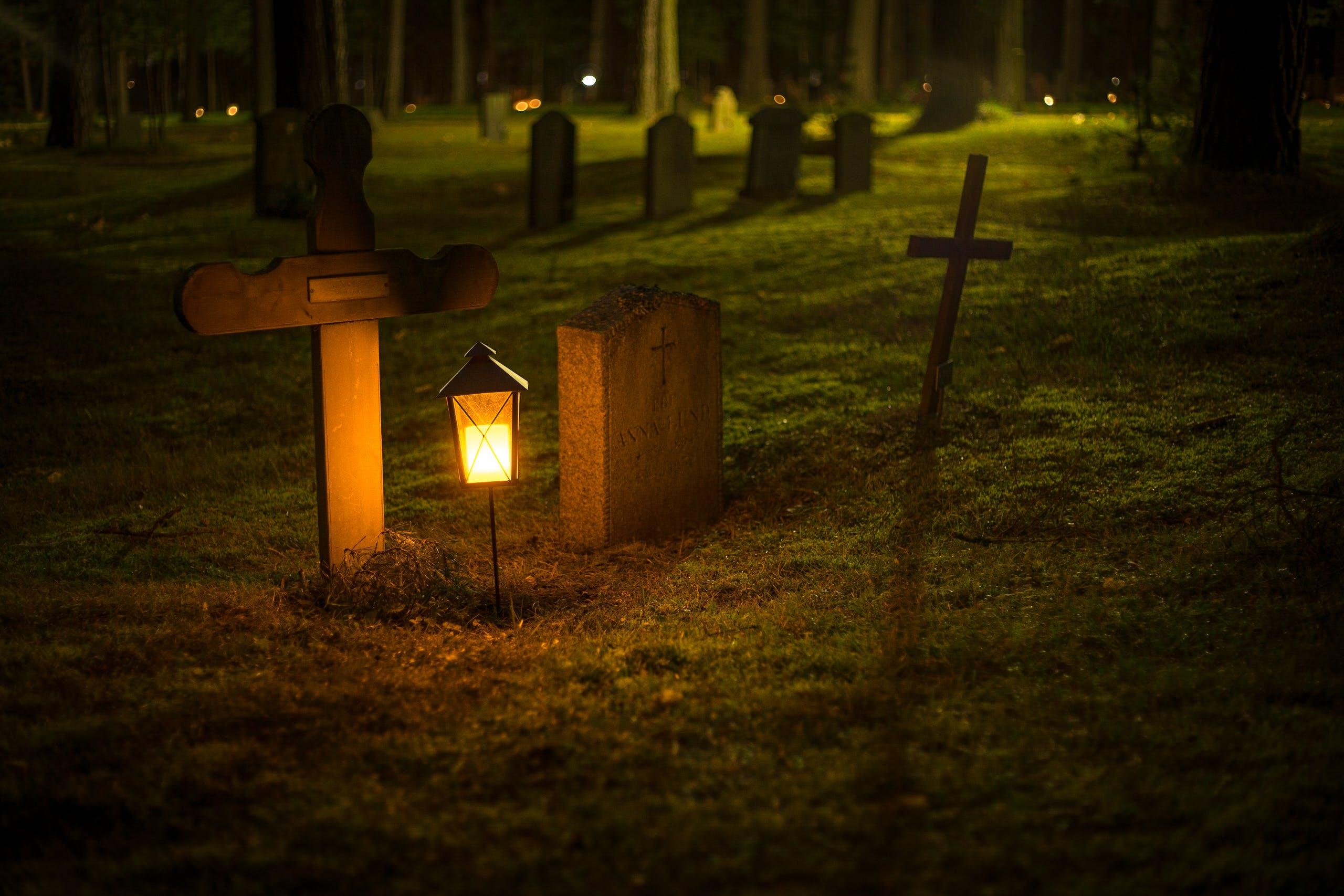 Selective Focus Photo of Cemetery Lantern