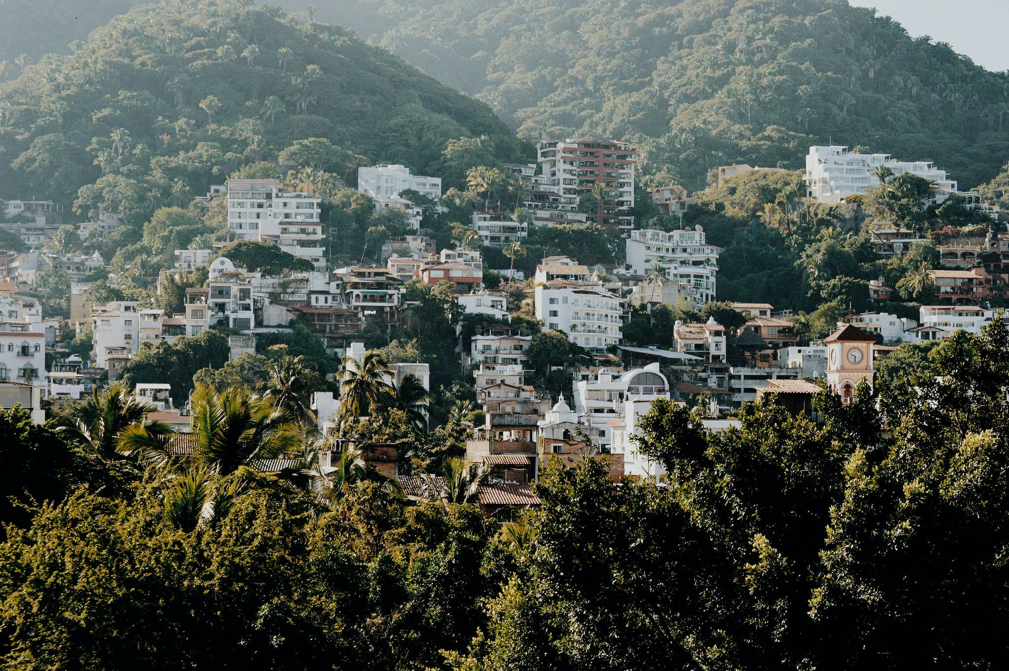 White and Brown Buildings on Mountain