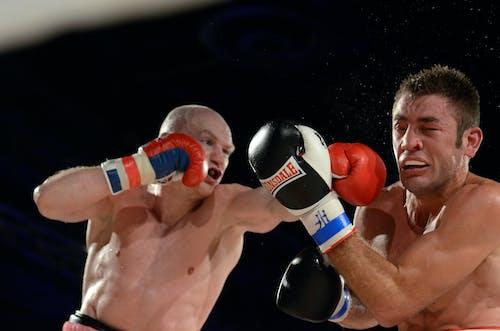 2 Men Boxing on Boxing Ring