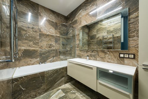 Interior of modern bathroom with marble walls