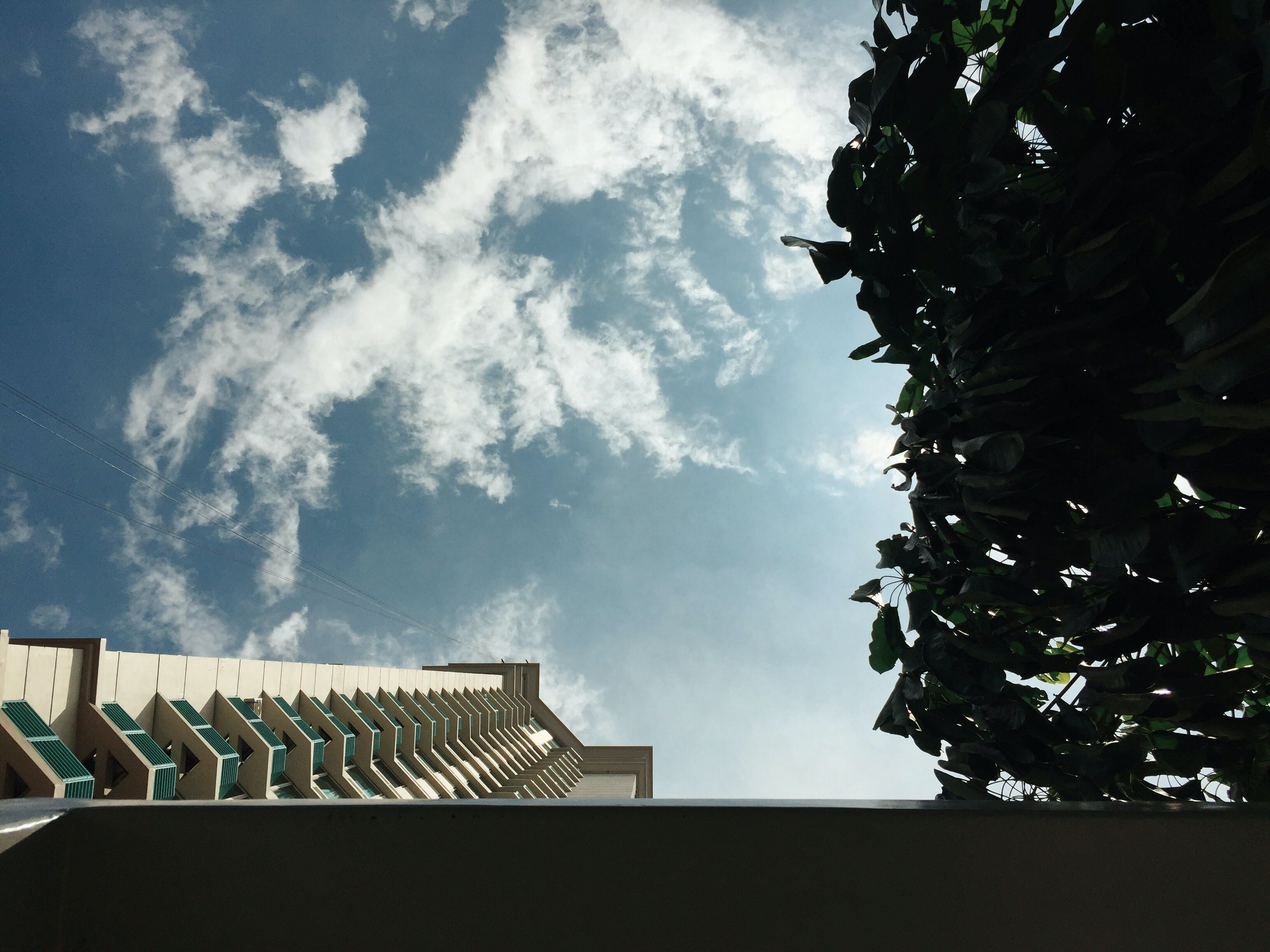 White Concrete Building With Cloudy Sky