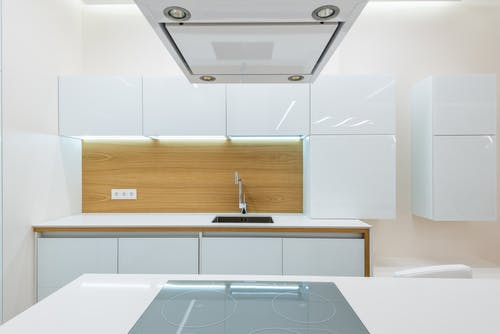 Clean kitchen with light interior