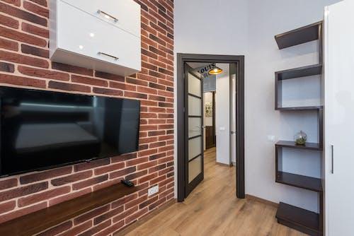 Modern room with TV and opened door