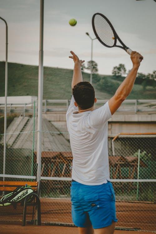 Tennis player hitting ball while playing tennis