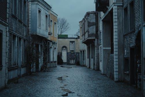 Narrow street between old buildings