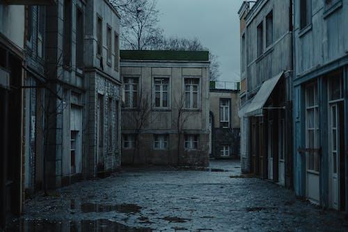 Sidewalk between shabby residential buildings