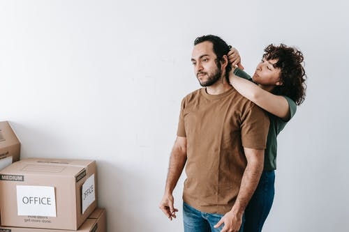 Woman Fixing The Hair Of A Man
