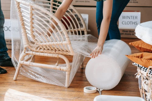 Person Using Bubble Wrap On A Chair