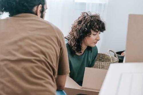Woman Looking At A Box