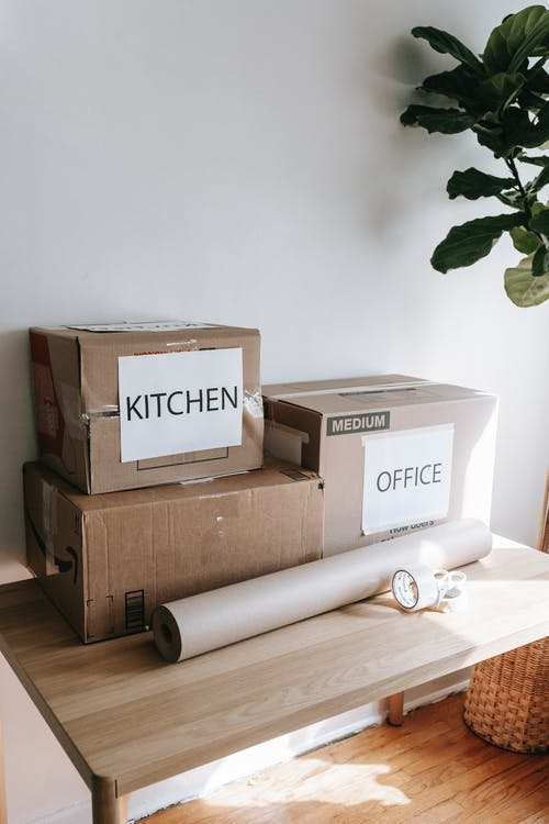 Packed Boxes On Wooden Table