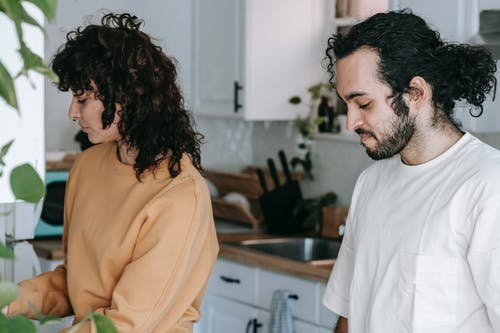 A Couple Standing In The Kitchen