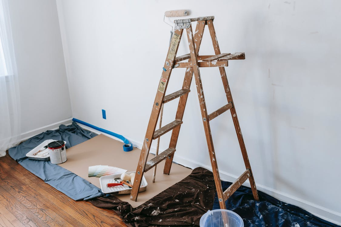A Dirty Wooden Stepladder In A Room