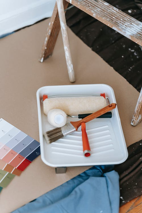 Paint Roller And Brush On A Tray