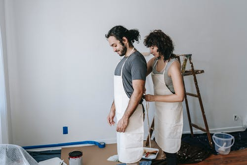 A Couple Wearing Their Work Clothes
