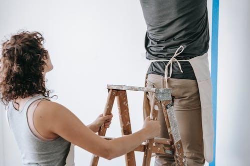 Woman Holding A Stepladder