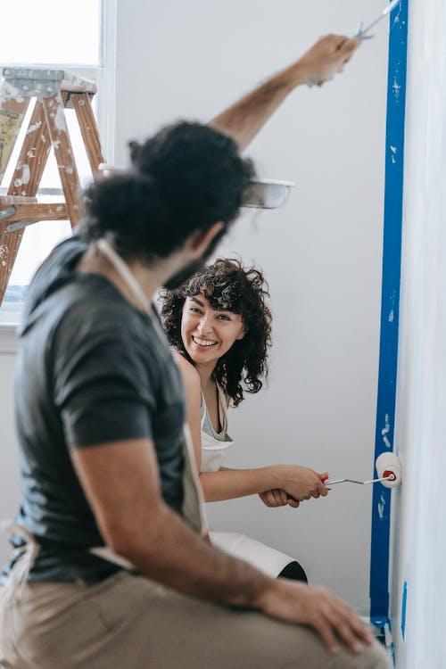 A Couple Enjoying While Painting