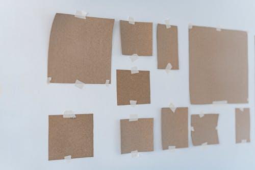 Brown Cardboards On Wall