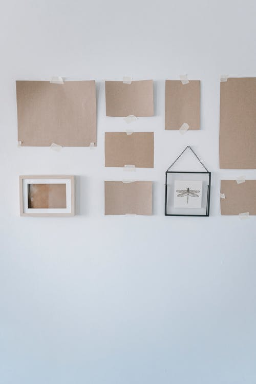Cardboards And Frames On Wall