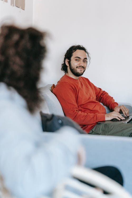 Man Sitting On A Couch With Computer