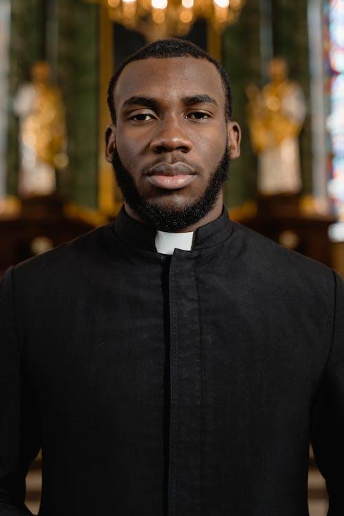 Man in Black Coat Standing