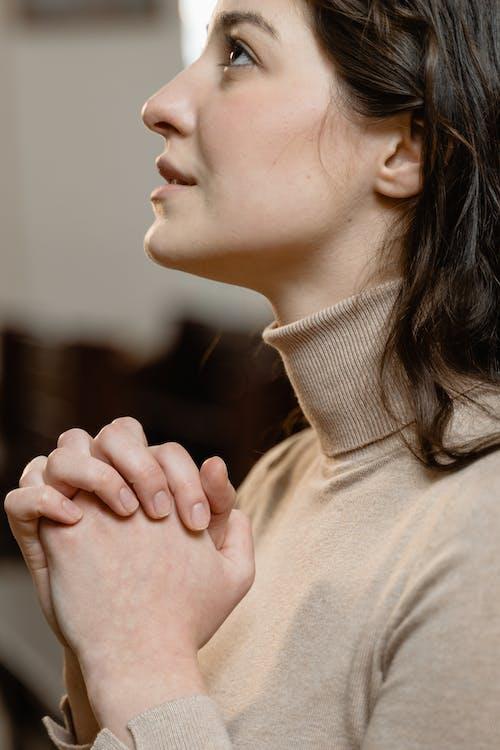 Close-Up View of a Woman Praying