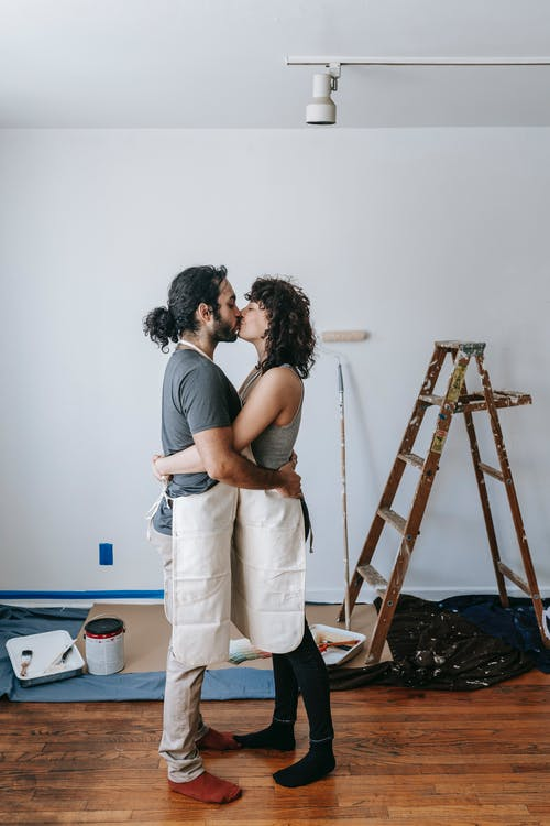 Couple Kissing While Having A Break At Work
