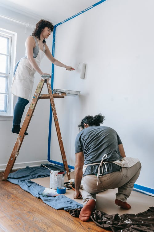 Couple Painting A Wall