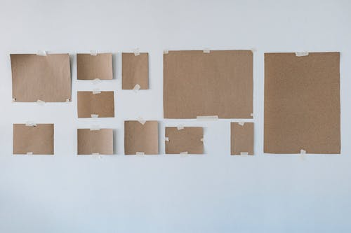 Cardboards From Picture Frames On Wall