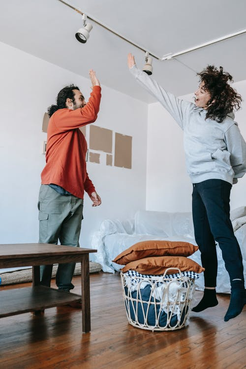 Couple Having Fun Time While Moving Out
