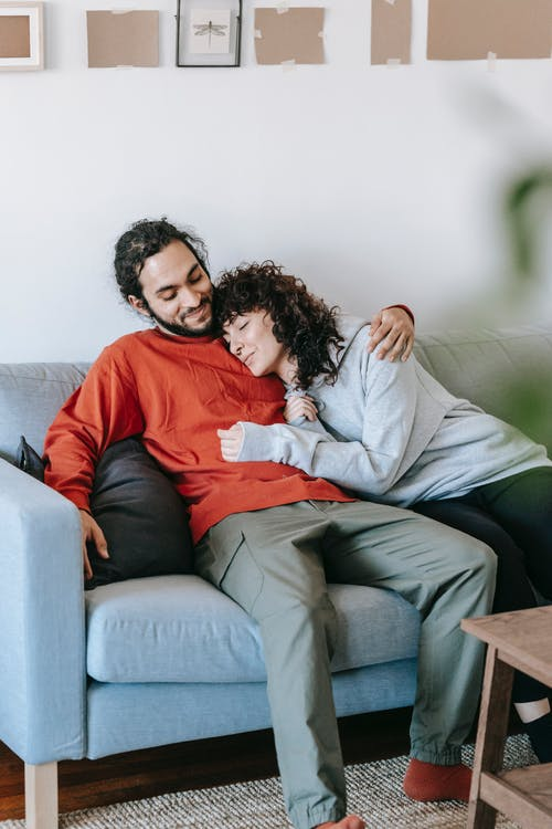 A Couple Relaxing On A Couch